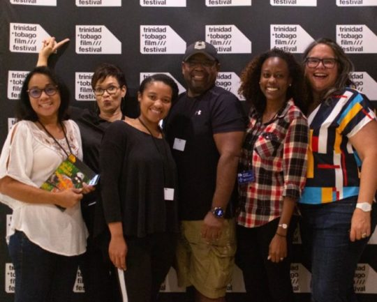 Image Caption: The FILMCO team poses for a photograph at the trinidad+tobago film festival.